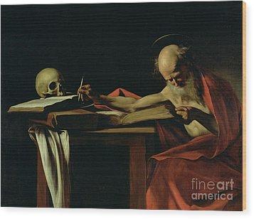 Saint Jerome Writing Wood Print by Caravaggio