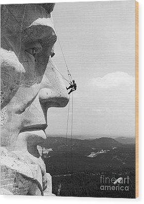 Scaling Mount Rushmore Wood Print by Granger