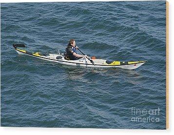 Sea Kayak Man Kayaking Off The Coast Of Dorset England Uk Wood Print by Andy Smy