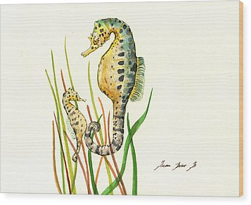 Seahorse Mom And Baby Wood Print by Juan Bosco