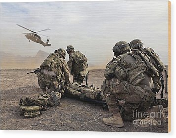 Security Force Team Members Wait Wood Print by Stocktrek Images