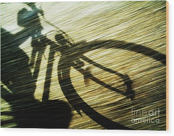 Shadow Of A Person Riding A Bicycle Wood Print by Sami Sarkis