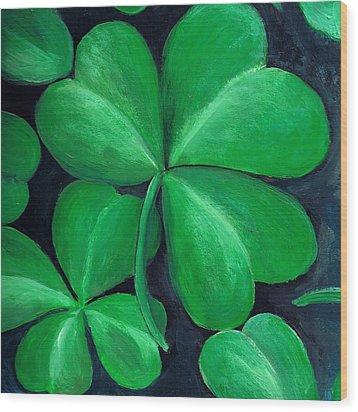 Shamrocks Wood Print by Nancy Mueller