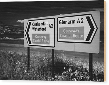 Signposts For The Causeway Coastal Route At Carnlough Between Cushendall And Glenarm County Antrim Wood Print by Joe Fox