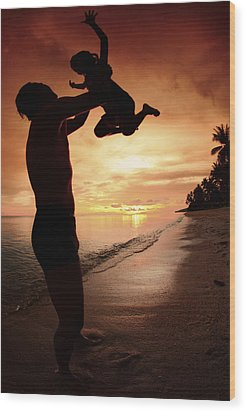 Silhouette Family Of Child Hold On Father Hand Wood Print