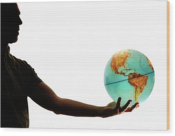 Silhouette Of Man Holding Globe Wood Print by Sami Sarkis