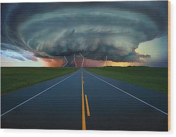 Single Lane Road Leading To Storm Cloud Wood Print by Don Hammond