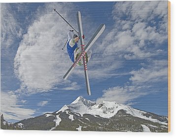 Skiing Aerial Maneuvers Off A Jump Wood Print by Gordon Wiltsie
