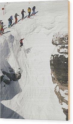 Skilled Skiers Plunge More Than 15 Feet Wood Print by Raymond Gehman
