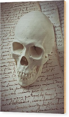Skull On Old Letters Wood Print by Garry Gay