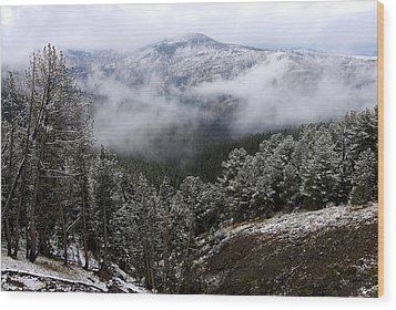 Snow And Clouds In The Mountains Wood Print by Larry Ricker