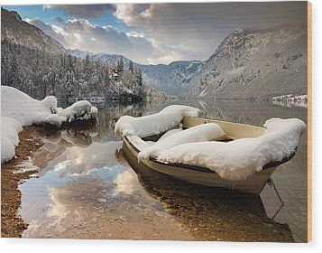 Snow Covered Boat On Lake Bohinj In Winter Wood Print by Ian Middleton