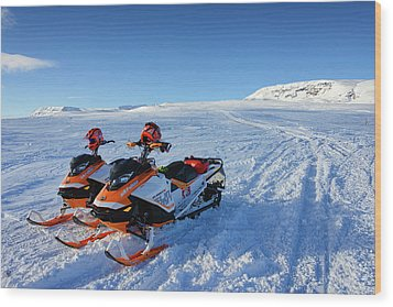 Wood Print featuring the photograph Snowmobiles In Iceland In Winter by Matthias Hauser