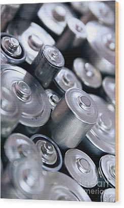 Stack Of Batteries Wood Print by Carlos Caetano