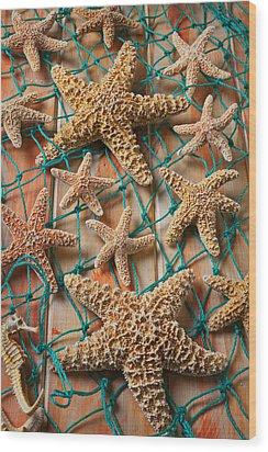 Starfish In Net Wood Print by Garry Gay