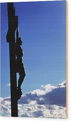 Statue Of Jesus Christ On The Cross Against A Cloudy Sky Wood Print by Sami Sarkis