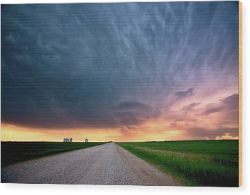 Storm Clouds Over Saskatchewan Country Road Wood Print by Mark Duffy