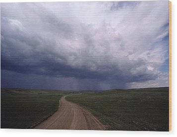 Storm Clouds Over The North Dakota Wood Print by Annie Griffiths