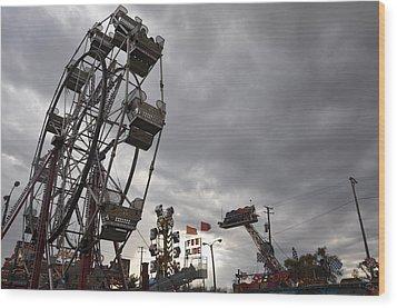 Stormy Ferris Wheel Wood Print by Daniel Ness