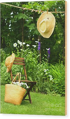 Straw Hat Hanging On Clothesline Wood Print by Sandra Cunningham