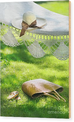 Straw Hat With Brown Ribbon Laying On Hammock Wood Print by Sandra Cunningham