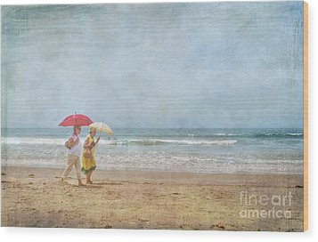 Wood Print featuring the photograph Strolling On The Beach by David Zanzinger