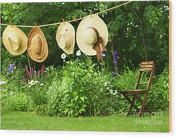 Summer Straw Hats Hanging On Clothesline Wood Print by Sandra Cunningham