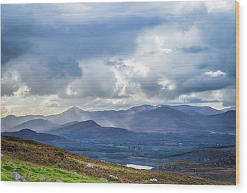 Sun Rays Piercing Through The Clouds Touching The Irish Landscap Wood Print by Semmick Photo