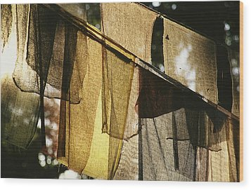 Sunlight Filters Through Prayer Flags Wood Print by Michael Melford