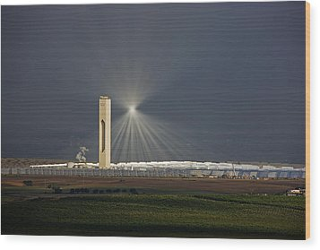 Sunlight Reflects Off Of Low Clouds Wood Print by Michael Melford