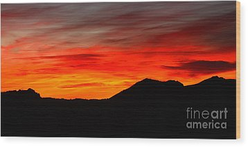 Sunrise Against Mountain Skyline Wood Print