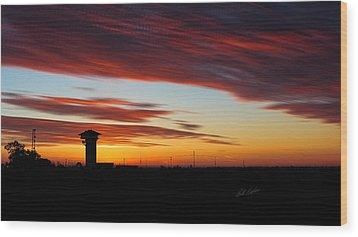 Sunrise Over Golden Spike Tower Wood Print by Bill Kesler