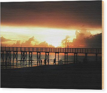 Sunset At The Pier Wood Print by Bill Cannon