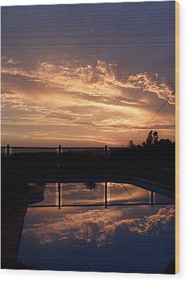 Sunset Over A Pool Wood Print by Edan Chapman