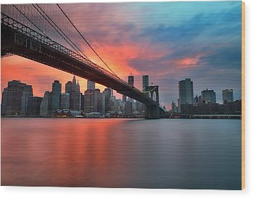 Sunset Over Manhattan Wood Print by Larry Marshall