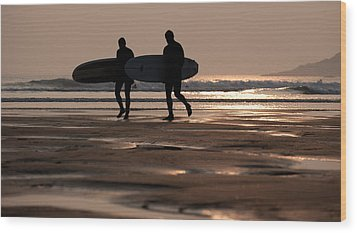 Surfers At Sunset Wood Print