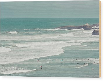 Surfers Lying In Ocean Wood Print by Cindy Prins