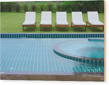 Swimming Pool And Chairs Wood Print by Atiketta Sangasaeng