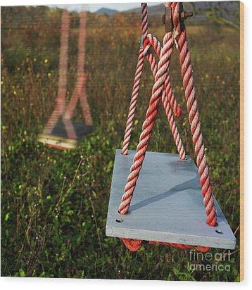 Swings Wood Print by Bernard Jaubert