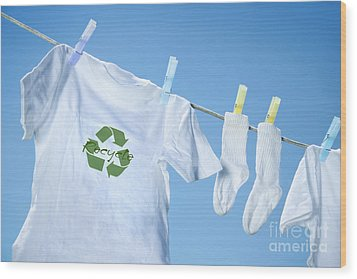 T-shirt With Recycle Logo Drying On Clothesline On A  Summer Day Wood Print by Sandra Cunningham