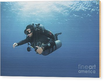 Technical Diver With Equipment Swimming Wood Print by Karen Doody