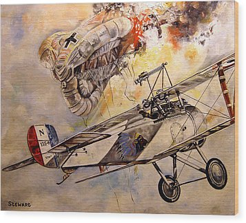 The Balloon Buster Wood Print by Marc Stewart