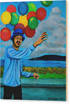 The Balloon Vendor Wood Print by Cyril Maza