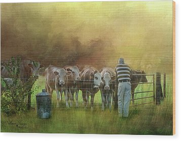Wood Print featuring the photograph The Cow Whisperer by Wallaroo Images