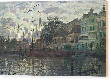 The Dam At Zaandam Wood Print by Claude Monet