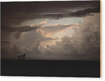 The Faint Lights Of A Gas Platform Wood Print by Wolcott Henry