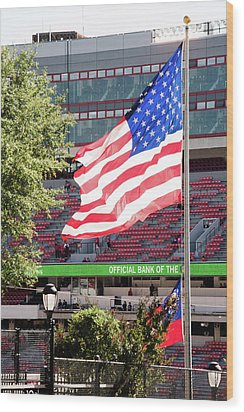 Wood Print featuring the photograph The Flag Flying High Over Sanford Stadium by Parker Cunningham