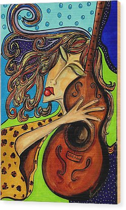 The Guitarist Wood Print by Yvonne Feavearyear