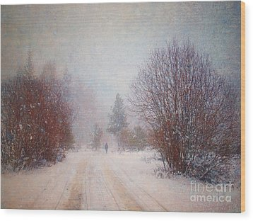 The Man In The Snowstorm Wood Print by Tara Turner