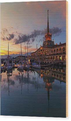 the nautical station and the yacht on the main sea channel of the Sochi seaport Wood Print